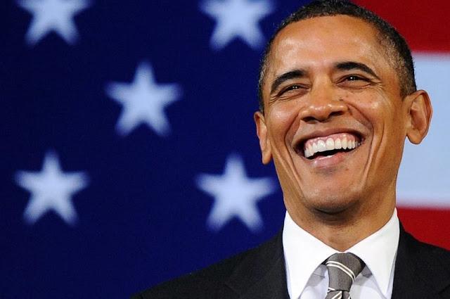 Tranh cãi về việc tổng thống Obama chụp ảnh tự sướng tại đám tang Nelson