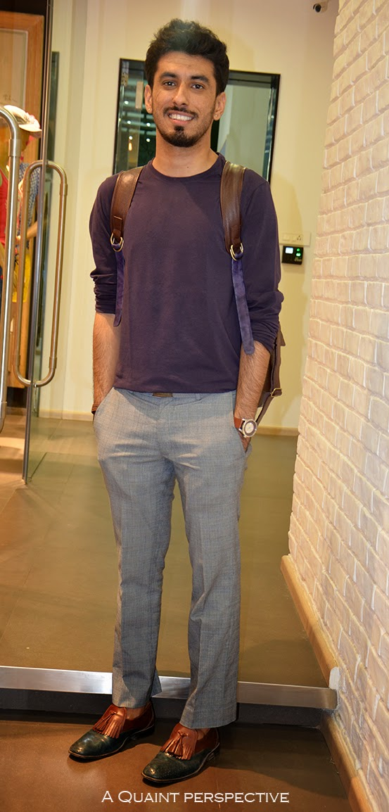 Karan seems to identify with and incorporate these in his personal style very well. He wears a crew neck long sleeve lightweight knit in purple with a smart fitted, tailored pair of trousers in grey prince of Wales checks, very subtle.