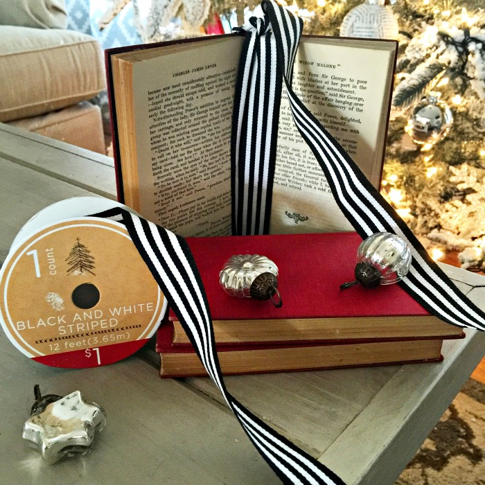 Small book made into a holiday ornament with striped Target dollar spot ribbon - www.goldenboysandme.com
