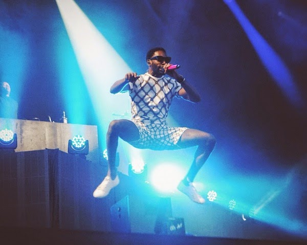 Tinie Tempah wears Jonathan Saunders Spring Summer 2015 menswear checked t-shirt and shorts at V Festival 2014 at Hylands Park.jpg