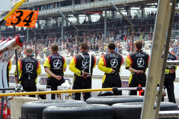 Crew of Michael Annett's team, the #7 Pilot/Flying J Chevrolet, stand in formation during the race opening ceremonies. #crownheroes #jww400 #reignon #nascar