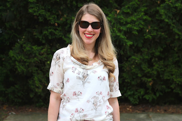 Floral blouse, flare jeans, laser cut blush heels