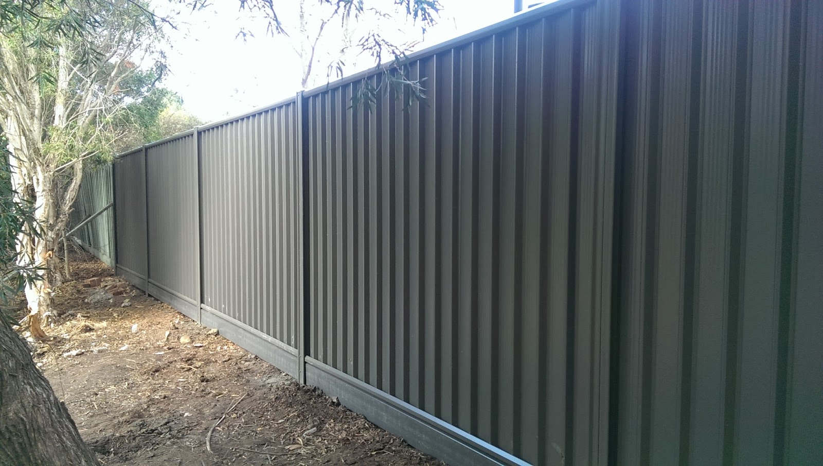 Ironman fencing metroll colorbond with pvc insert