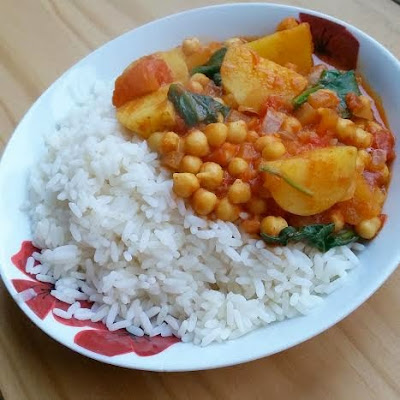 Vegan chana masala curry with potatoes, chickpeas and spinach