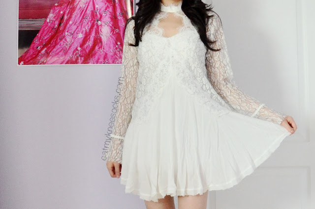 SheInside's lace crepe-hem dress is a great dupe of the Secret Origins pierced lace tunic by Free People, with a romantic design that's perfect for a springtime date.