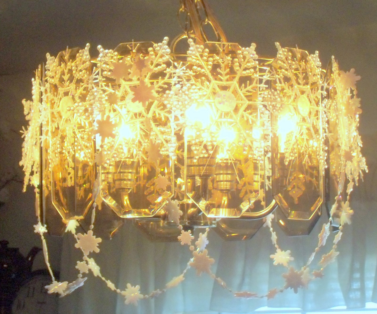 Make the best of things snowflake chandelier first version look at the beautiful crystally snowflakey chandelier i really really like it and so does the welding man it looks like a big christmas wedding cake mozeypictures Choice Image