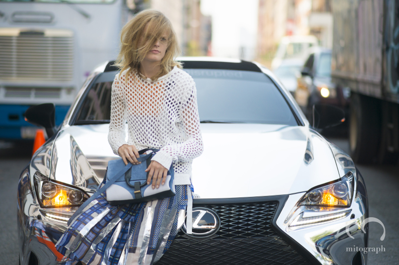 Model Hanne Gaby leans on Lexus mirrored car after Jason Wu show 2015 Spring Summer during New York Fashion Week NYFW