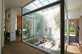 Maison et installations en vitre le patio la tendance du moment - Toit vitre maison ...
