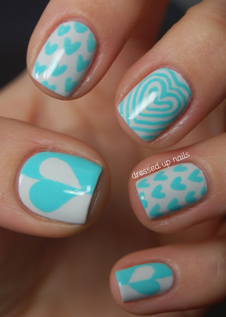 Turquoise heart nail art with Color Club Blue-ming and OPI My Boyfriend Scales Walls