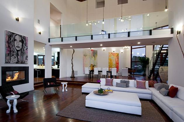 Picture of Rihanna's living room with the fireplace and high ceilings