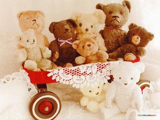 red wagon full of beige and brown stuffed teddy bears