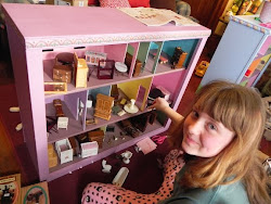 Turn a Kitchen Cupboard into a Doll House.