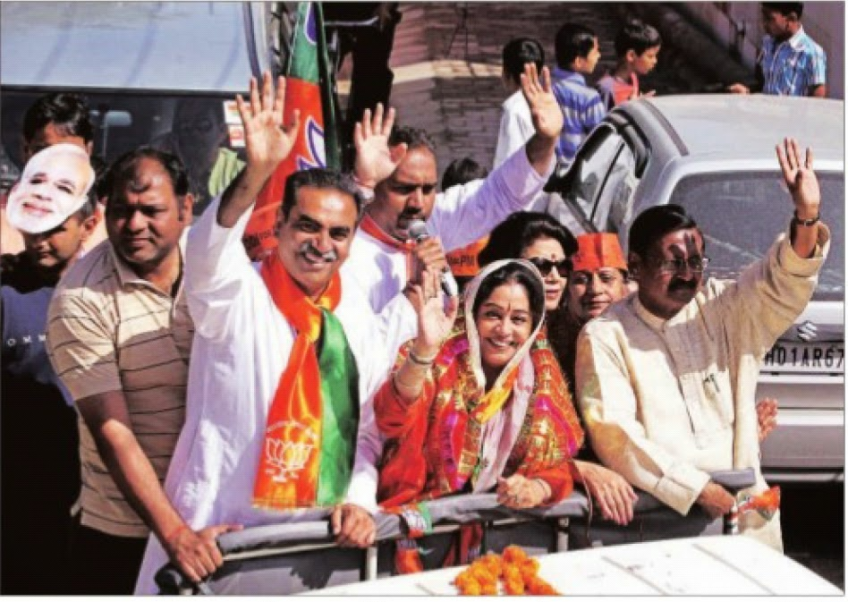 BJP candidate Kirron Kher with Ex-MP Satya Pal Jain on the campaigning in Khuda Lahora