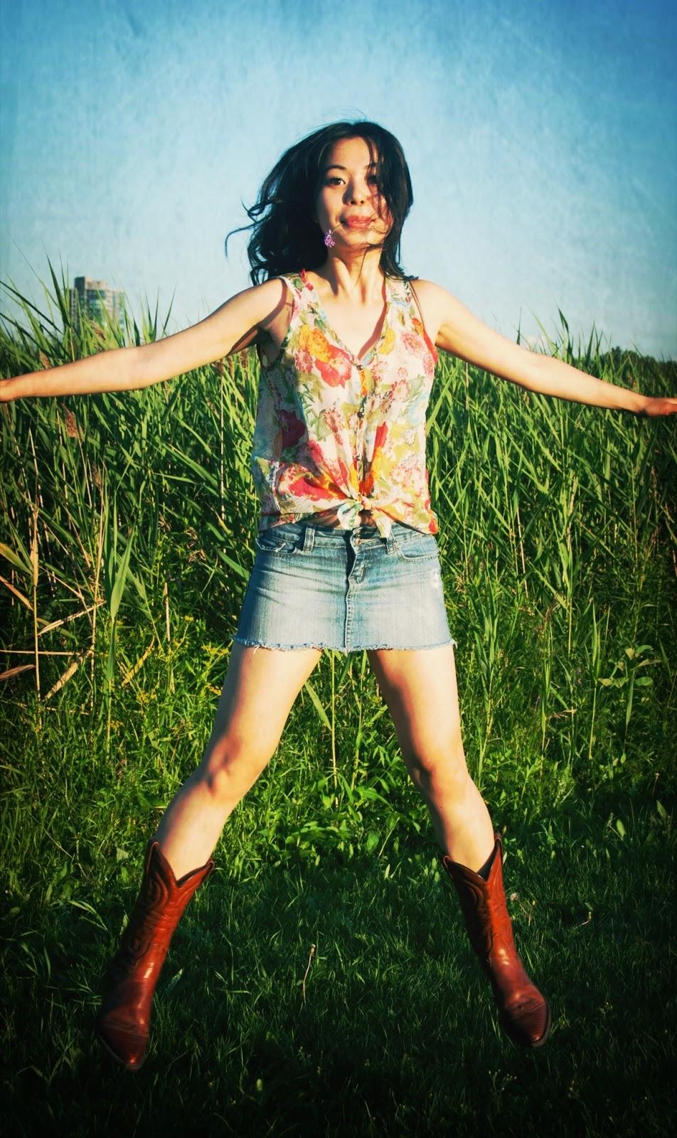 denim jean miniskirt cowboy boots floral top