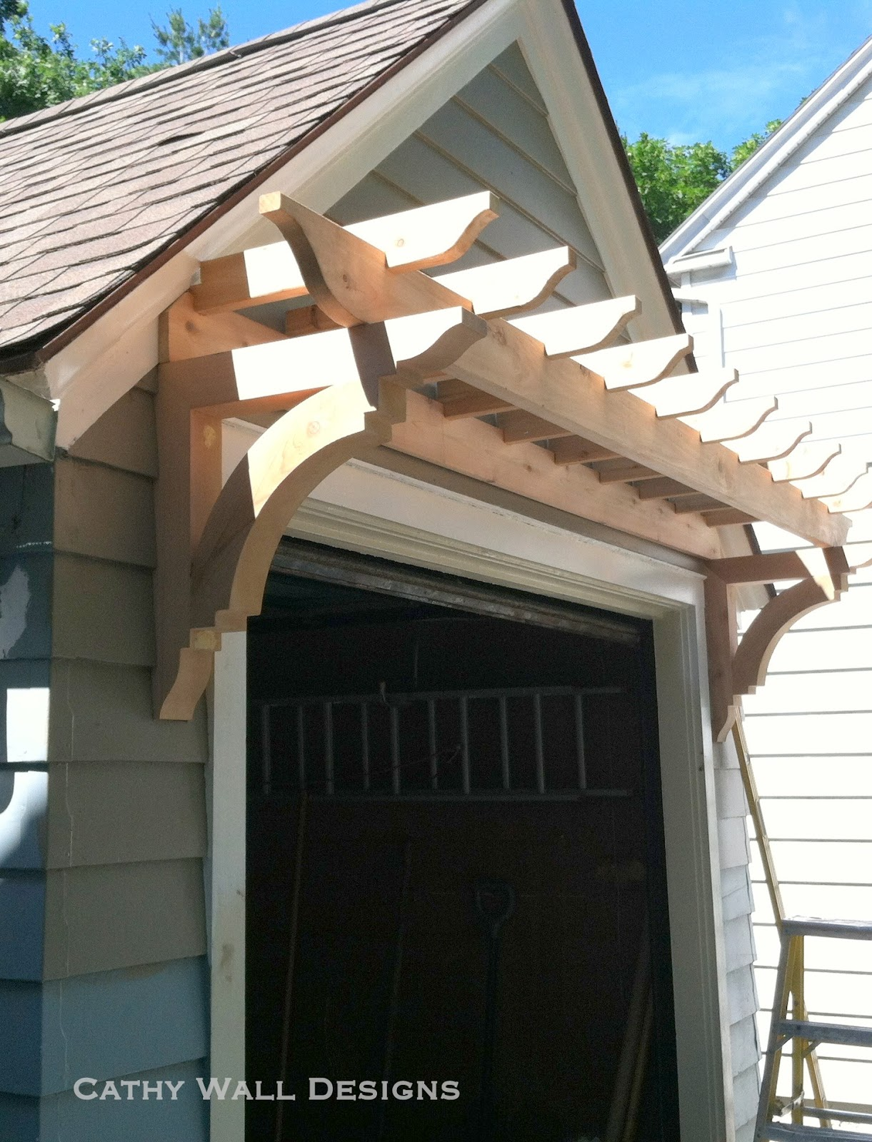 Pergola Over Garage Door : And painting is in progress