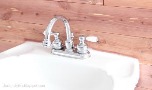 bathroom makeover cedar planked walls white sink