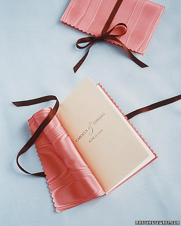 Wrap your programs in fabric that matches the colors of the wedding