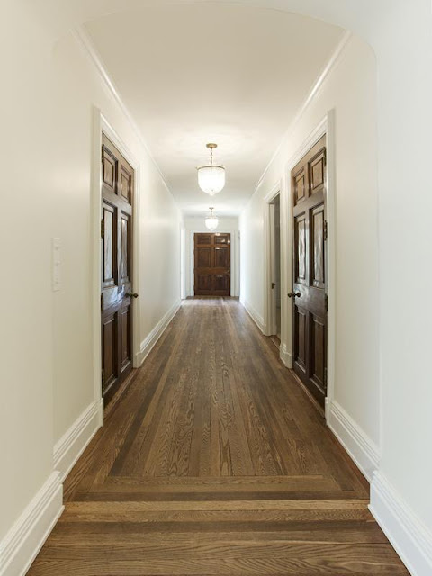 hallway with wood floor and white walls