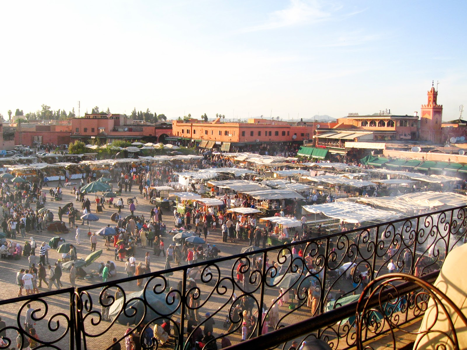 Marrakech top tourist attractions: Djemma El Fna - grand market getting set up for dinner during sunset