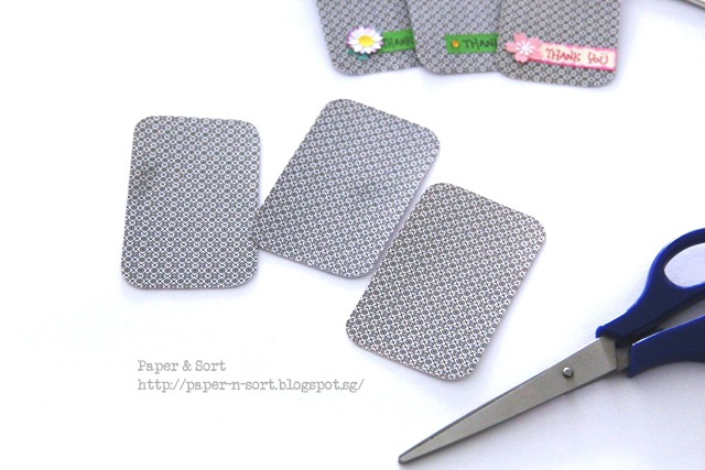 upcycle project - trim business card with scissors