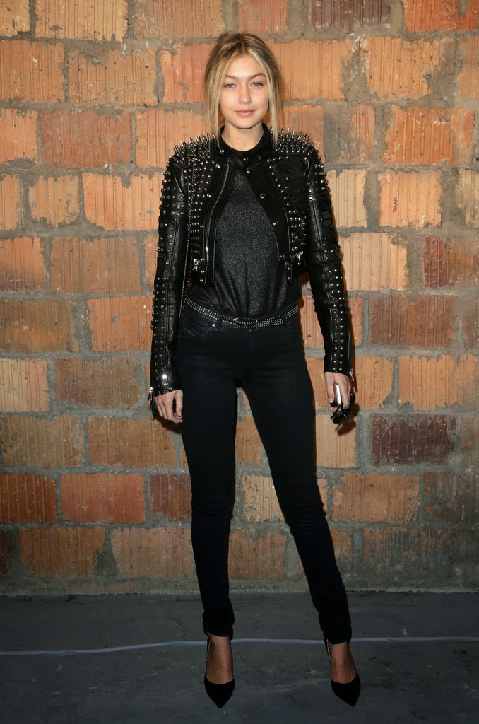 Gigi Hadid arrives to the Diesel Black Gold NYFW Show in a spiked studded leather jacket