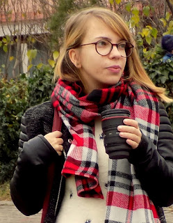 Cute, red and fluffy scarf for long walks in the city park.