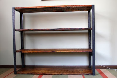 bookshelves made from recycled barn roofing boards