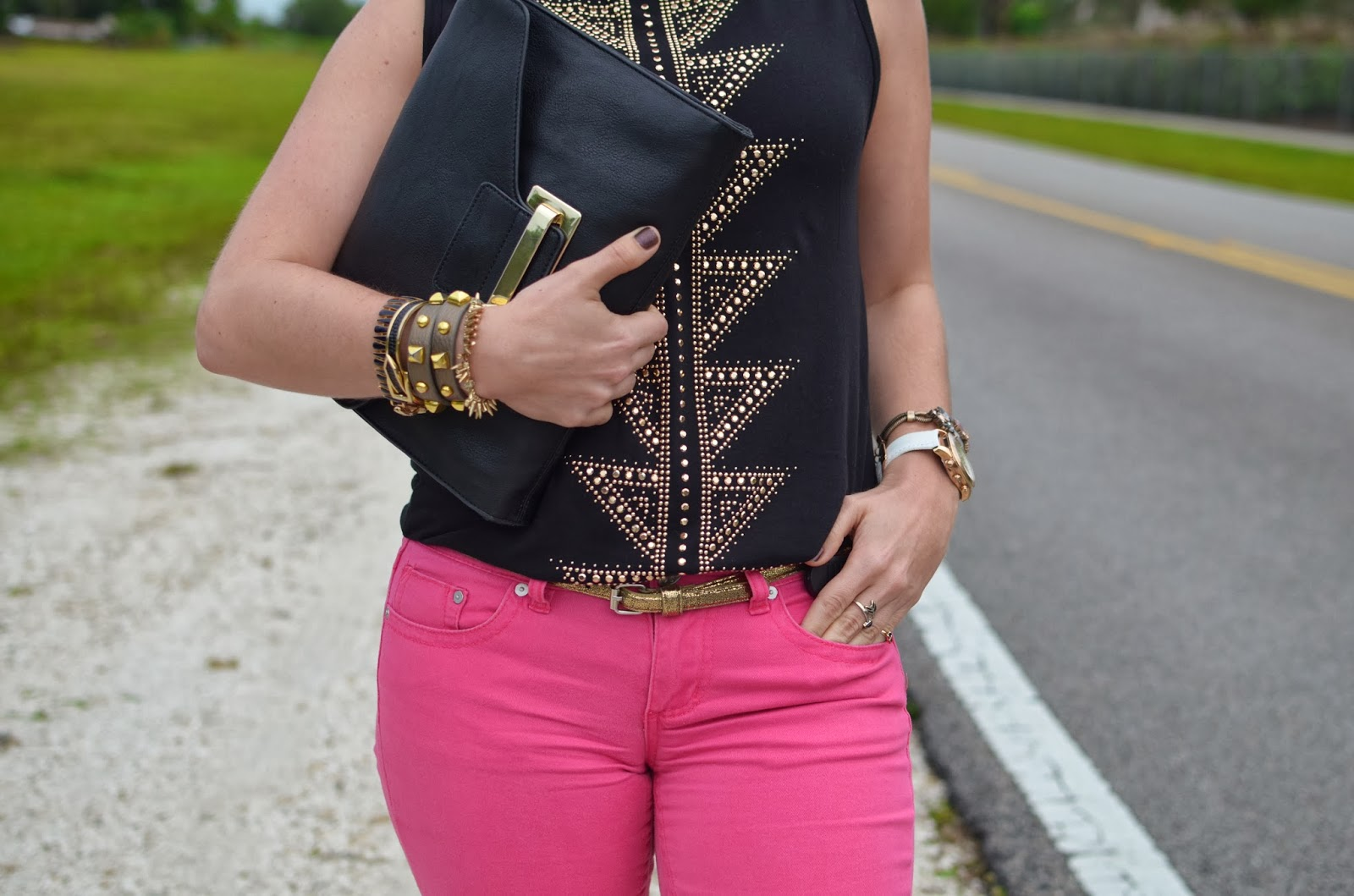 black clutch - studded tee - arm party