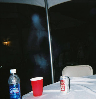Real Ghost Photo: Ghostly Apparition at a party