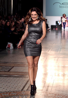 Kelly Brook on the catwalk modeling her creations