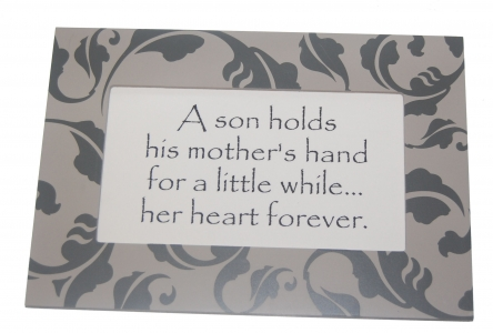 son holds his mothers hand for a little while... her heart forever.