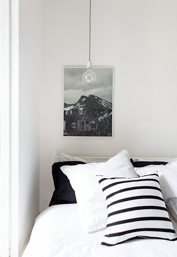 Bare bulb pendant lamps as bedside lighting | Image via Ollie and Seb's House