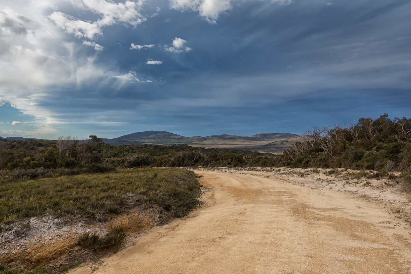 dark clouds over five mile road wilsons promontory