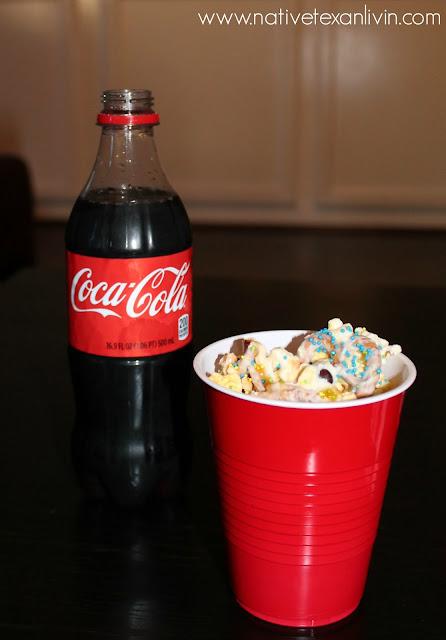 Coca-Cola & White Chocolate Trash Mix made with Orville Redenbacher popcorn, M&M'S®, pretzels & white bark