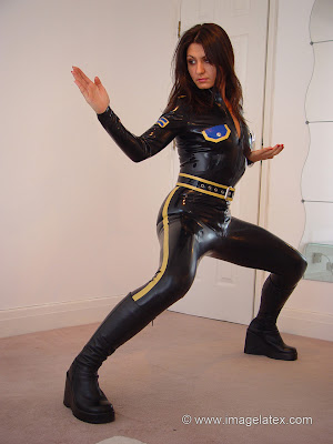 Karate Posing for Yara in Black Latex Police Catsuit