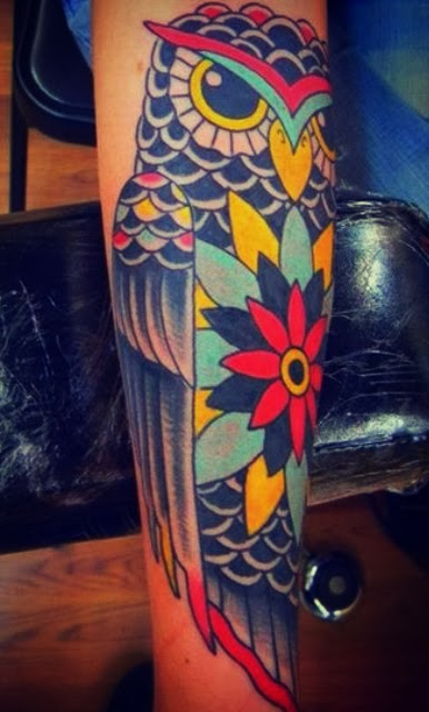 Tattoo of a floral owl in yellow, teal, navy and pink by Tattoo artist Mark Stewart for Triumph Tattoo