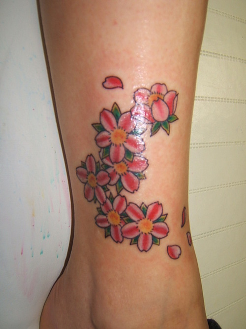 cherry blossom tattoos. at 12:02 PM - -