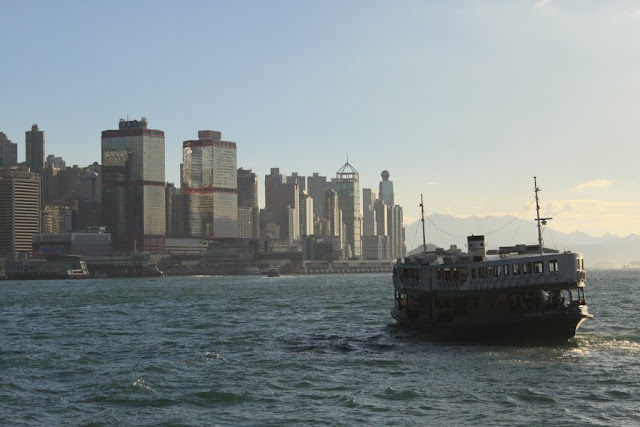 Skyline buildings with Star Ferry was captured in sunset in Hong Kong