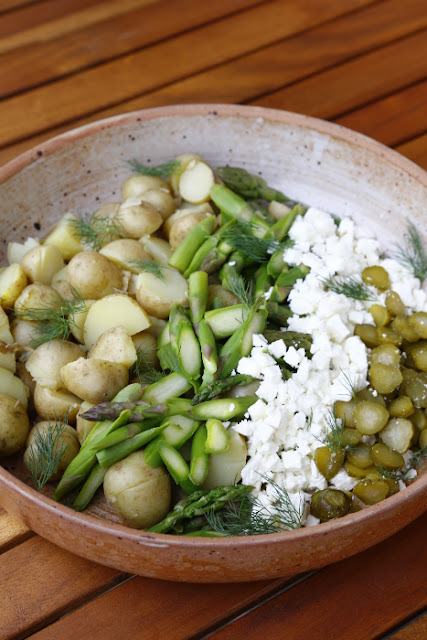 A salad of new potatoes, asparagus, feta and gerkins