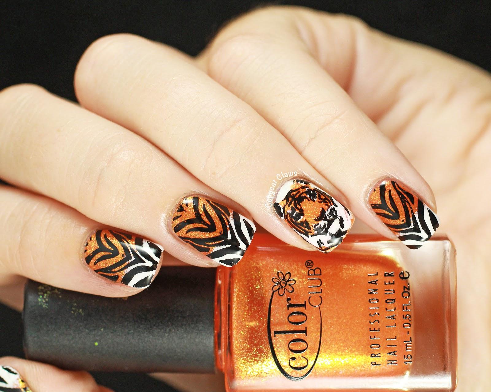Рисунки на ногтях фото тигровые