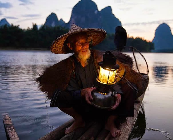 Old chinese fisherman with his lantern