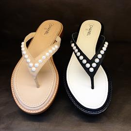 Chanel pearl flip flops.