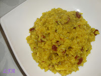 Arroz con curry, uvas pasas y nueces
