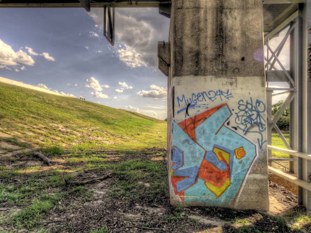Graffiti on the flood gates of the Buffalo bayou in George Bush Park - Houston, Texas - HDR