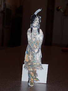 A close-up view of the Pilgrim/Indian girl paper doll craft...