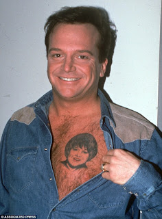 A whole lot of coffee and a little bit of crazy more for Tom arnold tattoo