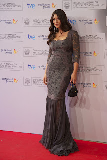 Monica Bellucci posing on the red carpet in an elegant grey gown