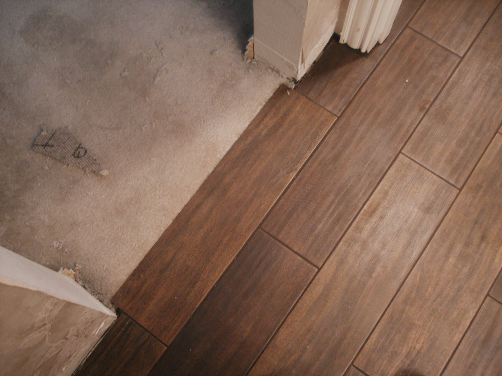 Is it wood flooring or is it porcelain tile Tile looks like wood floor