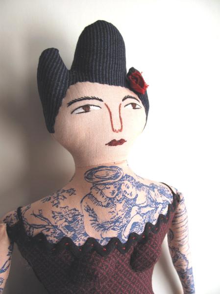 Mimi Kirchner's tattoed dolls width=100%  /></a></div> <br /> <div class=