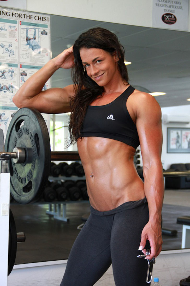Cindy Landolt Flexes Her Ripped Abs An Bicep In The Gym